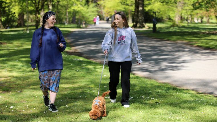 Volunteer and Mentor walking dog