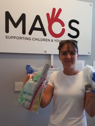 Volunteer Alison delivers art supplies
