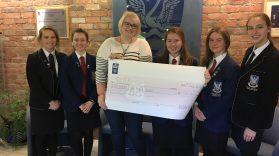 Glenlola Year 14 girls donate money to MACS