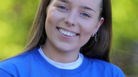 Portrait shot Sarah Jane smiling in MACS volunteers tshirt