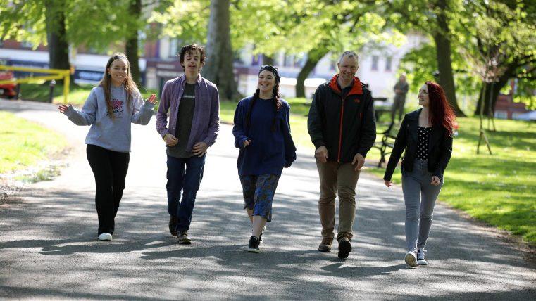 MACS Volunteers walking through a park