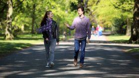Two MACS volunteers walking through Ormeau Park