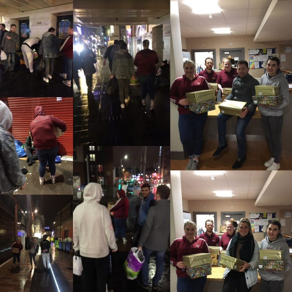 Young people give out essential goods to homeless people